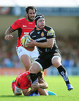 Thomas Waldrom of Exeter Chiefs looks to offload the ball. Aviva Premiership match, between Exeter Chiefs and Saracens on September 11, 2016 at Sandy Park in Exeter, England. Photo by: Patrick Khachfe / JMP