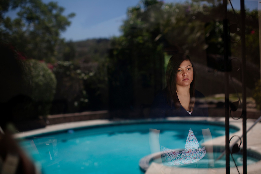 """CREDIT: Daryl Peveto / LUCEO..West Covina, California, May 12, 2010 - A portrait of Andrea Fleytas (cq), the Dynamic Positioning Operator on the Transocean Semi Submersible Exploratory Drilling Platform, Deepwater Horizon, that exploded on April 20 killing eleven contractors, at her mother's home. Fleytas, the only female Transocean employ on the vessel, stayed on for an hour after the explosion trying to right the oil rig. She eventually had to jump into the water and swim for 20 minutes before being rescued. The oil rig sank two days later causing what may be the worst oil spill in the history of oil exploration. Fleytas says she plans on taking a couple of months off to recover but is looking forward to returning to work. Adding, """"This experience has really taught me a lot about myself and how I handle my work."""""""