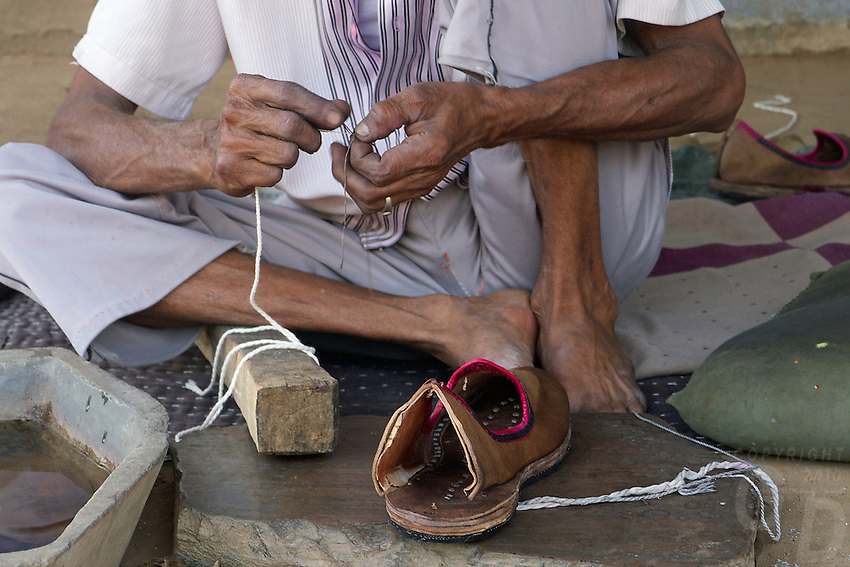 Traditional shoe maker in the small village of Narhet, Rajasthan India