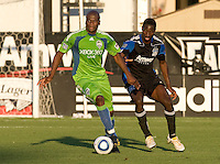 Blaise Nkufo of Sounders dribbles the ball away from Ike Opara of Earthquakes during the game at Buck Shaw Stadium in Santa Clara, California on July 31st, 2010.   Seattle Sounders defeated San Jose Earthquakes, 1-0.