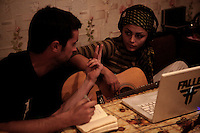 Maral and fellow White City band Member Travis discuss a song they are writing together.
