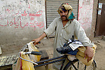 A man and his bicycle in Punjab village of Kahna, Pakistan.....
