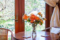 Vase of roses in Sally Robertsons' guest room