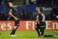 FUSSBALL   1. BUNDESLIGA   SAISON 2012/2013    19. SPIELTAG Hamburger SV - SV Werder Bremen                          27.01.2013 Sokratis Papastathopoulos und Nils Petersen (v.l., beide SV Werder Bremen)  sind enttaeuscht