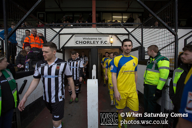 Chorley 2 Altrincham 0, 21/01/2017. Victory Park, National League North. The players walking on to the pitch at Victory Park, before Chorley played Altrincham (in yellow) in a Vanarama National League North fixture. Chorley were founded in 1883 and moved into their present ground in 1920. The match was won by the home team by 2-0, watched by an above-average attendance of 1127. Photo by Colin McPherson.