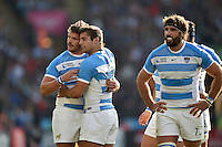 Julian Montoya of Argentina is congratulated on his try by team-mate Santiago Cordero. Rugby World Cup Pool C match between Argentina and Tonga on October 4, 2015 at Leicester City Stadium in Leicester, England. Photo by: Patrick Khachfe / Onside Images