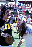 The Eagles 1978  Glenn Frey and Timothy B. Schmit celebrate at Eagles vs Rolling Stone Mag softball game.<br /> &copy; Chris Walter