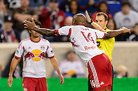 Thierry Henry (14) of the New York Red Bulls looks for a card from referee Matthew Foerster. The New York Red Bulls defeated FC Dallas 1-0 during a Major League Soccer (MLS) match at Red Bull Arena in Harrison, NJ, on September 22, 2013.