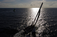 FRANCE,  Point Penmarc'h. 1st July 2012. Volvo Ocean Race, Leg 9 Lorient-Galway. PUMA Ocean Racing powered by BERG, with Groupama Sailing Team in the distance.