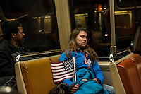 A woman rides the metro back from President Barack Obama's Inauguration on Monday, January 21, 2013 in Washington, DC.