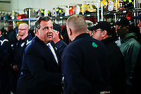 New Jersey Governor Chris Christie (L) salutes to the guest during a meeting in Keansburg in New Jersey. Jan 04, 2014. Photo by Eduardo Munoz Alvarez/VIEWpress