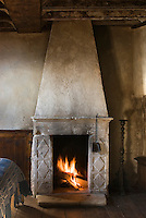 The stone fireplace is the only source of heating in the restored palazzo