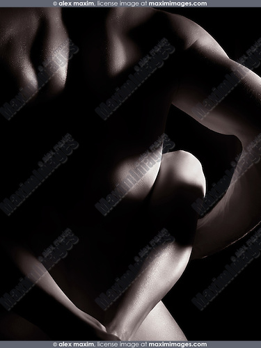 Couple making love, closeup of nude man back with woman legs crossed behind it, artistc nude black and white body parts abstract