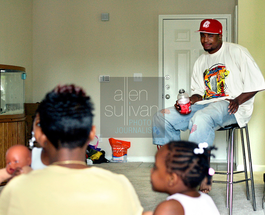 University of Georgia Bulldogs safety Greg Blue watches his sister Nastassia Webb play with her daughter Jaya and friend Kamiyah Ross in Stockbridge, Ga. during the televised NFL Draft on Saturday, April 29, 2006. Blue said the thought that he'll probably be somewhere across the country in a few days is a bit overwhelming. But Miami would be pretty nice, he said. He was picked by the Minnesota Vikings and is now a safety on the team.