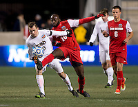 Harrison Shipp (10) of Notre Dame fights for the ball with Michael Kafari (10) of New Mexico during the NCAA Men's College Cup semifinals at PPL Park in Chester, PA.  Notre Dame defeated New Mexico, 2-0.
