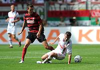 FUSSBALL   1. BUNDESLIGA  SAISON 2011/2012   1. Spieltag FC Augsburg - SC Freiburg            06.08.2011 Johannes Flum (li, SC Freiburg) gegen Daniel Baier (re, FC Augsburg)