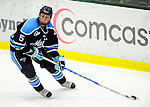 30 January 2010: University of Maine Black Bears' defenseman Josh Van Dyk, a Junior from Woodstock, Ontario, brings the puck out from behind his net during the third period against the University of Vermont Catamounts at Gutterson Fieldhouse in Burlington, Vermont. The Black Bears and the Catamounts played to a 4-4 tie in the second game of their America East weekend series. Mandatory Credit: Ed Wolfstein Photo