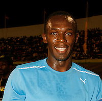 Usain Bolt is all smiles after his 100m victory on Saturday, May 3rd. at the Jamaica International Invitational Meet. Photo by Errol Anderson,The Sporting Image.