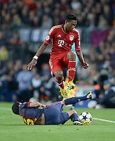 FUSSBALL  CHAMPIONS LEAGUE  HALBFINALE  RUECKSPIEL  2012/2013      FC Barcelona - FC Bayern Muenchen              01.05.2013 David Alaba (FC Bayern Muenchen) ueberspringt Xavi Hernandez (re, Barca)