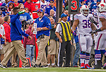 14 September 2014: Buffalo Bills head coach Doug Marrone works the sidelines during a game against the Miami Dolphins at Ralph Wilson Stadium in Orchard Park, NY. The Bills defeated the Dolphins 29-10 to win their home opener and start the season with a 2-0 record. Mandatory Credit: Ed Wolfstein Photo *** RAW (NEF) Image File Available ***