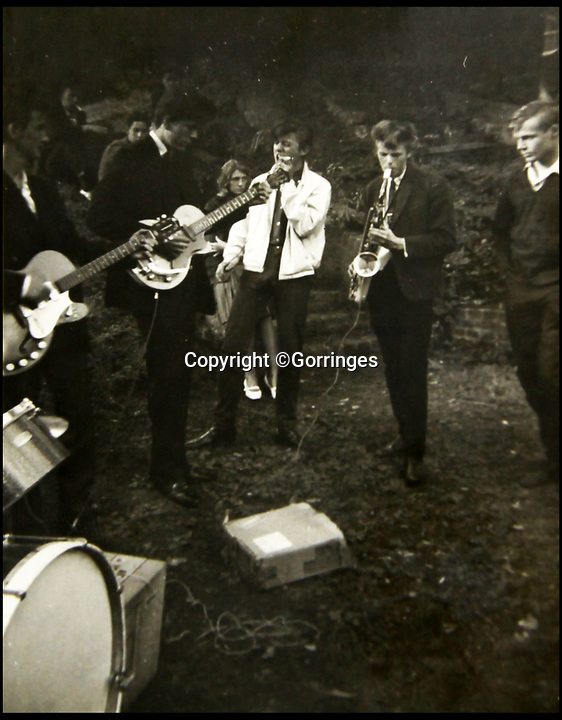 BNPS.co.uk (01202 558833)<br /> Pic: Gorringes/BNPS<br /> <br /> Unseen picture of a fifteen year old David Bowie playing a saxophone in his first ever band.<br /> <br /> A never before seen photograph of a 15 year-old David Bowie playing the saxophone in his first band has been unearthed after 55 years.<br /> <br /> The late music icon formed the Konrads in 1962 who played halls, clubs and pubs in and around Bromley in south east London.<br /> <br /> He had yet to adopt the 'Bowie' persona so he was still known as his real name Davy Jones.<br /> <br /> The photo was taken by Sue Beal, 69, who saw him play at her local youth club in Keston.<br /> <br /> The retired former secretary, from Uckfield in Kent, has decided to put the unpublished photo which she has treasured for more than five decades up for auction and it is tipped to sell for &pound;80.