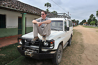 Sitting on the front of a Land Cruizer, San Lorenzo de Moxos, Beni, Bolivia