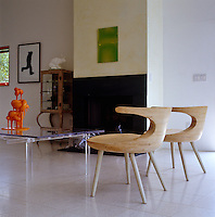The wooden chairs in the living room are prototypes of chairs designed by Peter Franck and Kathleen Triem