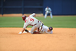 Arkansas' Monk Kreder steals second as the ball gets by Mississippi second baseman Alex Yarbrough (2) in a college baseball game at Oxford-University Stadium in Oxford, Miss. on Sunday, May 9, 2010. Arkansas won 7-0.