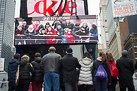 Advertising for Hyundai automobiles in Times Square in New York is seen on Monday, January 21, 2013. Tourists standing on the red steps can see themselves on the Hyundai screen. (© Frances M. Roberts)