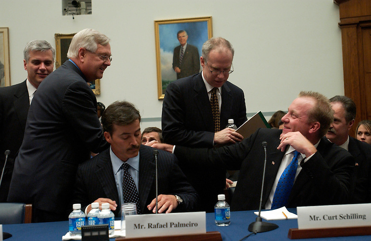 """03/17/05.STEROIDS IN BASEBALL--Rep. Curt Weldon, R-Pa., greets Rafael Palmeiro, current Baltimore Oriole and former Texas Ranger, and Curt Schilling, current Boston Red Sox, during a break in the House Government Reform hearing called, """"Restoring Faith in America's Pastime: .Evaluating Major League Baseball's Efforts to Eradicate Steroid Use."""".CONGRESSIONAL QUARTERLY PHOTO BY SCOTT J. FERRELL"""
