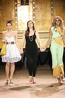 Aninka Bags designer Anna Kavaschova, walks runway with models at the close of the Slovak Fashion Night runway show, May 13, 2011.