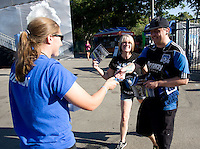 Earthquakes staff gives away sunglasses, sponsored by Alaska Airlines, to the fans before the game at Buck Shaw Stadium in Santa Clara, California on August 11th, 2012.   Earthquakes defeated Sounders, 2-1.