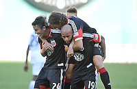 Kyle Porter (19) of D.C. United celebrates his score with teammates Lewis Neil and Dejan Jakovic.  D.C. United tied the Los Angeles Galaxy 2-2, at RFK Stadium, Saturday September 14 , 2013.