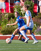 Boston Breakers midfielder Leslie Osborne (12) passes the ball as Chicago Red Stars midfielder Jen Buczkowski (4) comes in to tackle.  The Boston Breakers beat the Chicago Red Stars 1-0 at Dilboy Stadium.