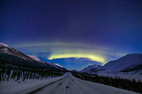 Aurora borealis swirls across the sky over interior Alaska and the James Dalton Highway.