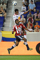 Roy Miller (7) of the New York Red Bulls goes for a header over Michael Lahoud (11) of Chivas USA. The New York Red Bulls defeated Chivas USA 1-0 during a Major League Soccer (MLS) match at Red Bull Arena in Harrison, NJ, on June 5, 2010.
