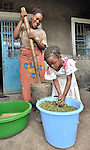 Kanund Njamo grinds moringa leaves at her home in Kamina, Democratic Republic of the Congo, with the help of her daughter Sango Vero. The Moringa (moringa oleifera) is an exceptionally nutritious tree with a variety of uses. It has the potential to improve nutrition, boost food security, foster rural development and support sustainable landcare. In the Congo, the United Methodist Committee on Relief (UMCOR) promotes the cultivation and use of moringa. Njamo is one of the program beneficiaries...
