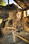 The wood oven is the centerpiece of the dining experience at Konoba Humac. . .Konoba Humac, owned by the Franicevic family,  is a restaurant which combines traditional Croatian tavern food with an exotic setting in the abandoned agricultural village of Humac on a mountain peak on the Island of Hvar, Croatia. All the food is organic and picked by its diners from the fields nearby. Konoba Humac is an entrepreneurial combination of traditional dining and ecotourism trends. Photo copyright 2007 www.lawrencelucier.com