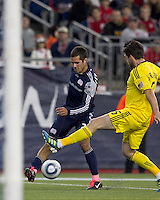 New England Revolution midfielder Benny Feilhaber (22) passes the ball as Columbus Crew midfielder/defender Danny O'Rourke (5) defends. In a Major League Soccer (MLS) match, the Columbus Crew defeated the New England Revolution, 3-0, at Gillette Stadium on October 15, 2011.