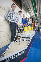 """Team Last Minute"" poses with their Techtanic entry in Brooklyn Technical High School's Cardboard Boat Regatta in Brooklyn in New York on Friday, March 1, 2013. As part of Engineering Week the teams of students constructed boats made only of cardboard and duct tape. The team's assigned ""captain"" piloted their boat from one end of the pool to the other and back in a heat with other boats, hopefully without sinking. The surviving boats were timed and the winners received bragging rights with an award also going to the most spectacular sinking. (© Richard B. Levine)"