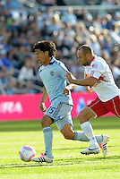Roger Esopinoza (15) Sporting KC midfielder goes past Joel Lindpere, midfileder Red Bull...Sporting Kansas City defeated New York Red Bulls 2-0 at LIVESTRONG Sporting Park, Kansas City, Kansas.
