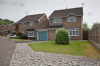 Pantile and brick two storey detached houses in Rosedale Av, Stonehouse, Gloucestershire