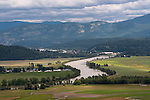 Agricultural fields around the Kootenai River with the town of Bonners Ferry below the Cabinet mountains