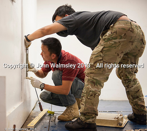 Gurkhas, leaving the British army, on a training course to work in the construction industry, here fitting a radiator,  Able Skills training centre, Dartford, Kent.