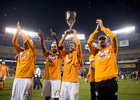 Houston Dynamo captain Brad Davis holds the trophy aloft after the game at RFK Stadium in Washington,DC. D.C. United tied the Houston Dynamo, 1-1.  With the tie, Houston won the Eastern Conference and advanced to the MLS Cup.