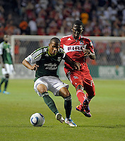 Portland defender Jeremy Hall (17) controls the ball in front of Chicago forward Patrick Nyarko (14).  The Portland Timbers defeated the Chicago Fire 1-0 at Toyota Park in Bridgeview, IL on July 16, 2011.
