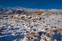 711700262 winter sunrise with snow covered granite boulders in the bureau of land management protected land the alabama hills in the southern section of the eastern sierras with lone pine peak  and mount russell in the background in kern county california