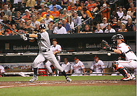 Ichiro Suzuki #51 of the Seattle Mariners slices the ball past Matt Weiters #32 of the Baltimore Orioles during a MLB game at Camden Yards, on August 8 2010, in Baltimore, Maryland. Orioles won 5-4 in extra innings.