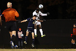 24 November 2013: Wake Forest's Tolani Ibikunle (4) heads the ball over Navy's Geoff Fries (15). The Wake Forest University Demon Deacons played the Naval Academy Midshipmen at Spry Stadium in Winston-Salem, NC in a 2013 NCAA Division I Men's Soccer Tournament Second Round match. Wake Forest won the game 2-1.