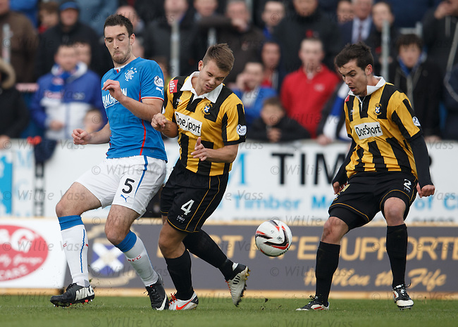 Lee Wallace eases Gary Thom off the ball as Alexis Dutot watches on